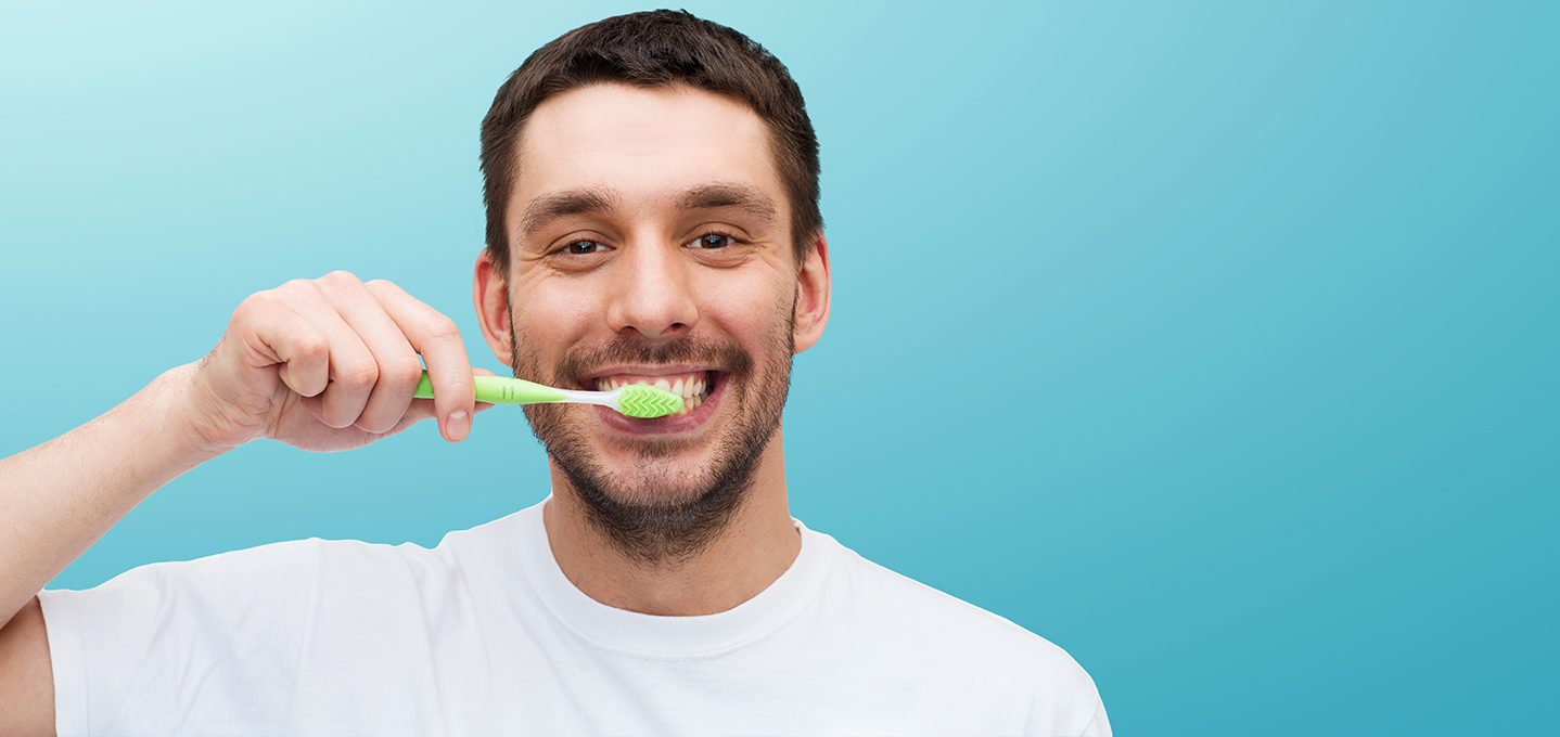 Image description: a young man brushing his teeth.